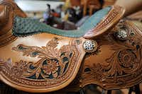 One of leather artist Jerry Shaw's horse saddles in his work space in McKinney, Texas on August 15, 2012. Shaw does does everything from guitar straps to chairs, but his main focus is horse saddles.