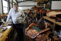 Leather artist Jerry Shaw in his work space in McKinney, Texas on August 15, 2012. Shaw does does everything from guitar straps to chairs, but his main focus is horse saddles.