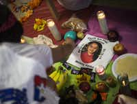 During the   Día de los Muertos  celebration on Sunday, participants placed offerings on a community altar in remembrance of those who have died, including a girl who was killed by a hit-and-run driver while she was playing in the neighborhood.(Andrew Buckley - Special Contributor)