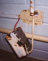 In a picture taken by the state in 2009, electrical wiring is shown at the Bridgeport Health Care Center northwest of Fort Worth in Wise County. The Texas Department of Aging and Disability Services asked a state judge to name a trustee to take over day-to-day management of the home, the only time the state has used the tool in the past three years. The home is now closed.