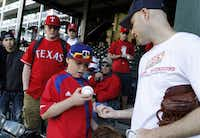 Zack Hample thrilled 11-year-old Harrison McCoy by giving him one of the balls he snagged Friday at The Ballpark.