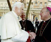 ORG XMIT: *S0419310079* Pope Benedict XVI greeting Bishop Kevin Farrell, with Archbishop Donald W. Wuerl, Archbishop of Washington, in the background, shot on June 28, 2006. CREDIT: L'Osservatore Romano 03072007xNEWSLÕOsservatore Romano