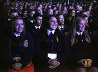 Hannah Ford (center), 18, of Peaster, with fellow FFA members Candace Schiegg (left) and Shelby Brasher, was on hand for the opening session of the Texas FFA State Convention at the Dallas Convention Center on Tuesday.