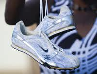 Shania Gray excelled on her high school's track team and owned a pair of running shoes signed by Olympian track star Michael Johnson.