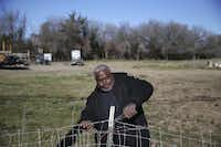 Mark Carter helped take down an old fence Wednesday on an 18-acre plot of land donated to Bonton Farm near Seagoville. Farm workers and volunteers were preparing an entryway and perimeter fencing on the land.(Andy Jacobsohn - Staff Photographer)