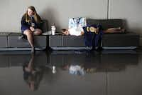 FFA members Bethany Lindgren, 15, and Kaela Hudman, 15, both of Timpson,  took a lunch break during the 85th annual Texas FFA State Convention at the Dallas Convention Center on Wednesday.