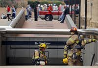 Dallas Fire Rescue responded to the two-alarm fire outside an entrance to the Thanksgiving Tower building parking garage Thursday. The fire took place underneath the tower.(G.J. McCarthy - The Dallas Morning News)