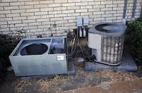 A broken air conditioner sits at the apartment complex in the 1500 block of Dewberry Boulevard.( G.J. McCarthy  -  Staff Photographer )