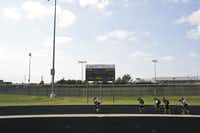 Wrestlers run a lap on the track while carrying a teammate during practice at Birdville High School in North Richland Hills, TX. on Friday Oct. 12, 2012.