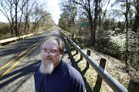 E.R. Bills, who wrote  Slocum Massacre , stands near Sadler Creek. Somewhere along the creek in 1910, a band of whites opened fire on three black men. It was the start of two days of slaughter whose details have mostly been lost to time.(Vernon Bryant - Staff Photographer)