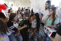 Nora Rubi (center), 18, is consoled by friends during a memorial cookout for Jose Cruz at Bachman Lake. (Ben Torres/Special Contributor)