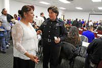 Maria Puente of Pleasant Grove talked with Reserve Officer Ana Arrona after Puente received her Citizens Police Academy certificate Nov. 14.