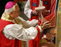 Retired Bishop James Stanton, left, places a mitre on Bishop-elect George R. Sumner during a service for the ordination and consecration of Rev. George R. Sumner as the seventh Bishop of the Episcopal Diocese of Dallas at First United Methodist Church on Saturday, Nov. 14, 2015, in Dallas. (Jae S. Lee/The Dallas Morning News)(Jae S. Lee - Staff Photographer)