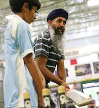 Seven-year-old Aansh Jha of Plano observes as Kuljit-Singh Nijjar, who started the league, coaches.(Andy Jacobsohn - Staff Photographer)