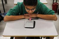 Brandon Gomaz, a student in Jesse Fletcher's seventh grade LEAD gifted reading class, reads from an e-reader during his fourth period class at Killian Middle School in Lewisville.
