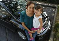 "Waitress Yasmin Flores, with her daughter, Yvette, says her car frees her from a bus that ""may not be on time.""(File 2014 - Staff Photo)"
