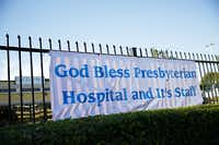 A sign near Texas Health Presbyterian Hospital proclaims support.(G.J. McCarthy - The Dallas Morning News)