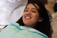 Robina Rayamajhi smiles while having a temporary crown installed by Dr. Philip Kozlow in Addison.