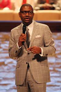 Senior Pastor Bryan Carter led the service at Concord's new worship center on Sunday in South Dallas.