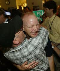 Michael receives a kiss from staff photographer David Leeson (left) as the photo staff of The Dallas Morning News celebrates their 2006 Pulitzer. Michael was the leading photographer in the News' Hurricane Katrina coverage. (Mei Chun-Jau/Dallas Morning News)
