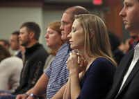 The daughter of Cynthia McLelland, Christina Tomlinson, clasped her hands as she waited on Dec. 17, 2014 to hear whether the jury sentenced the killer of her mother and stepfather to death. Sitting next to her is her brother, Nathan Foreman and then his wife, Julie McFaul.