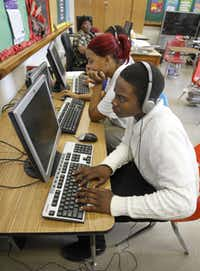 Students Kentrelle Gambles and Ebony Johnson work on computers in Mary Norris' class at Roosevelt High School in Dallas.