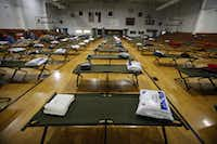 Cots await in an emergency shelter for evacuees and workers of the fertilizer plant explosion in West, Texas,(Brad Loper - Staff Photographer)