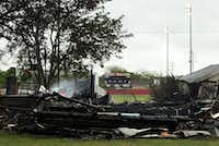 The remains of a burned building sit just south of the West ISD School stadium.(Brad Loper - Staff Photographer)