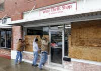 Charlie Yarborough, Pete Galvan, and Jay McNeil work on boarding up the West Thrift Shop in downtown West near the fertilizer plant explosion.Vernon Bryant - Staff Photographer