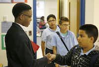 Former student Kendell Long was greeted by Kevin Salinas, an incoming sixth-grader attending camp last week at the Obama Academy.( Andy Jacobsohn  -  Staff Photographer )