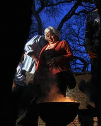 Dora Stahl of Richardson and others gathered near a fire of burning herbs during a cleansing and smoke prayer for spring at St. Thomas Episcopal Church in Dallas.