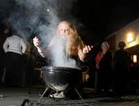 Lynn Price of Dallas waves herb smoke to her face during a cleansing and smoke prayer at the second annual spring equinox celebration at St. Thomas Episcopal Church in Dallas.