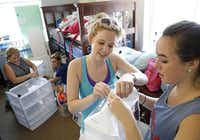 Dorothy Oehmler (center) and Kaitlyn Waggoner work on a shoe rack in Ware Commons as moms Kris Waggoner (left) and Elizabeth Pounders take on a different project.Vernon Bryant  -  Staff Photographer