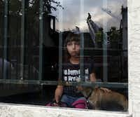 Chyanne Crouch, 9, watched from a window in her apartment building as firefighters battled the nearby fire.