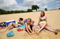 Lewisville Lake's Stewart Creek Park had plenty of sun and sand for Eliana Terrell (left) of The Colony, her 6-year-old nephew, Elijah Eguia, and her sister, Priscilla Gonzalez of Chicago.( Andy Jacobsohn  -  Staff Photographer )