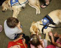 Students at West Elementary School petted therapy dogs from Lutheran Church Charities on their first day back to school after last week's explosion at a fertilizer plant.