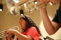 Camper Valeria Ibarra, 17, of Krum, Texas, practices the trumpet during an exercise session with other trumpeter at the University of North Texas Mariachi Aguilitas Summer Camp in the UNT Music Building in Denton, Texas Wednesday July 23, 2014. Ibarra has been attending the camp for six years.(Andy Jacobsohn - Staff Photographer)