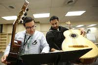 Camp instructors Adolfo Estrada (left) and Jason Molina (right) prepare a lesson plan for the next session at the University of North Texas Mariachi Aguilitas Summer Camp.(Andy Jacobsohn - Staff Photographer)