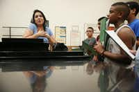 Camp instructor Michelle Quintana gives voice lessons to campers at the University of North Texas Mariachi Aguilitas Summer Camp.(Andy Jacobsohn - Staff Photographer)