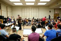 Camp instructor Jose Hernandez (standing up left center), founder of the mariachi ensemble 'Mariachi Sol de Mexico,' leads a session at the University of North Texas Mariachi Aguilitas Summer Camp.(Andy Jacobsohn - Staff Photographer)