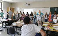 "Teacher Shannon Ozols (center) led a ""link up"" exercise to help students get to know one another on the first day of classes Monday at the new Reedy High School in Frisco.( Vernon Bryant  -  Staff Photographer )"