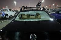 Hail took out the rear windshield of a car parked at Love Field Airport Tuesday night.