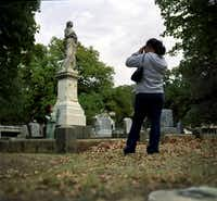 Elizeth Juarez photographs her daughter, Itzel Ibarra, as the family stroll through the Pioneer Cemetery.