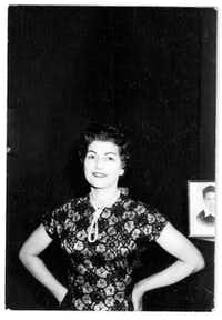 Betty was dressed to the nines when she sang with bands in West Virginia and Ohio, even though money was tight. A photo of her oldest son, Crys, can be seen behind her in this late 1950s photo taken at home.