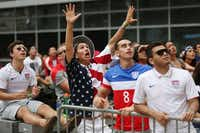 Reza Askari (from left) and Austin Broyles of Coppell and Michael Elizalde and Danny Ray Escalante of Dallas pivoted from excitement to dismay as the U.S. soccer team missed a goal attempt.( Andy Jacobsohn  -  Staff Photographer )