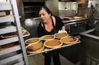 Salvation Army worker Teresa Flores loads a tray of pumpkin pies for the shelter's annual Thanksgiving feast.
