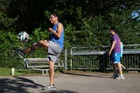Jose Vazquez, of Dallas, kicks a soccer ball on the Katy Trail near the Katy Trail Ice House in Dallas Wednesday April 27, 2016. (Andy Jacobsohn/The Dallas Morning News)
