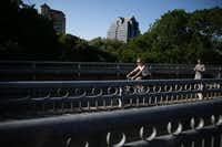 Bicyclists and pedestrians utilize the Katy Trail near the Katy Trail Ice House in Dallas Wednesday April 27, 2016. (Andy Jacobsohn/The Dallas Morning News)