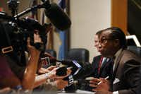 """John Wiley Price answered reporters' questions during the regular meeting of Dallas County commissioners on Tuesday. """"I'm proceeding with business as usual,"""" he said."""