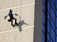 Clayton Dean, dressed as Batman, rappelled down the side of the InterContinental Dallas Hotel in Addison as part of a fundraiser for Special Olympics Texas on Friday.  Dean raised $2,900 for Special Olympics Texas.